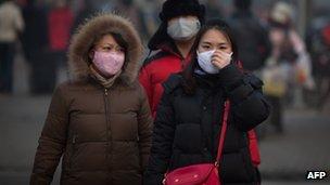 People weariing masks